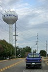 Mike driving his truck past the water tower in Starkville Mississippi near the Mississippi State University campus.