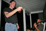 Mike drinking strawberry daiquiris on the front porch.
