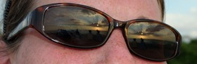 Can you see the sunset reflected in my sunglasses?... It's a sign of things to come. CLICK to see a larger version!