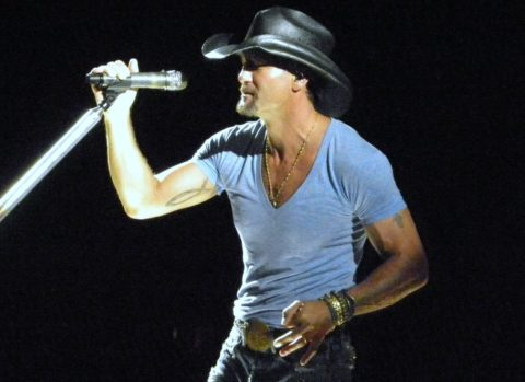 Tim McGraw singing at the microphone.