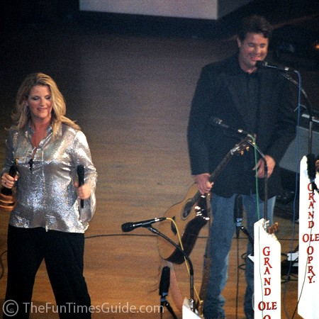 Trisha Yearwood and Vince Gill performing at the Grand Ole Opry.