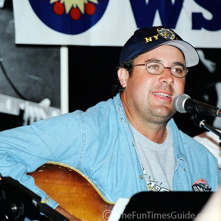 Vince Gill playing the guitar at the Bluebird Cafe in Nashville, Tennessee.