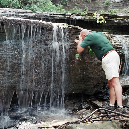 Jim cooling off in the waterfall along the Natchez Trace.
