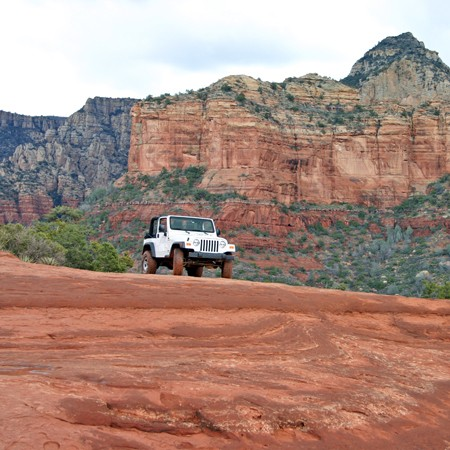 Our Jeep atop the majestic and beautiful Red Rock.