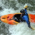 A whitewater kayaker using hand paddles at Hell's Hole on the Lower Ocoee.