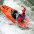 A whitewater freestyle kayaker using his hands as paddles at Hell's Hole on the lower Ocoee River.