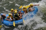 A boatload of whitewater rafters at Hell's Hole rapid on the lower Ocoee River.