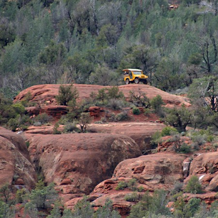 A yellow Jeep high atop the Red Rocks of Sedona.